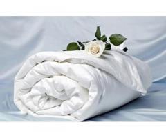 Професійна чистка подушок, перин та ковдр з заміною напірника.