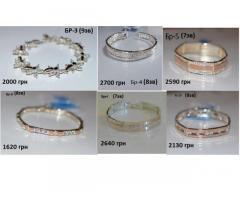 Серебренные браслеты с золотой вставкой