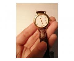Годинник Eberhard & Co золотий.