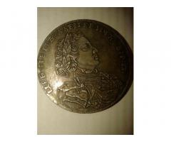 Продам серебряную монету 1 рубль Петра 11707 года.